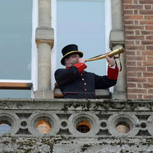 Bellman, Julian Tubb, on the balcony of the Town Hall, sounding the Lucas horn calling Commoners to Court