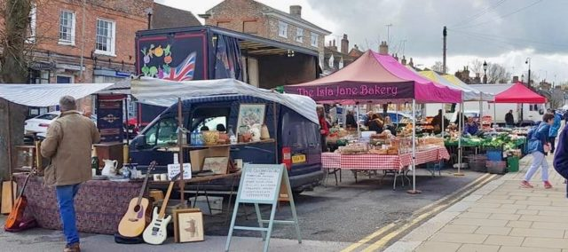 Market day in Hungerford - showing a variety of stalls, with food, collectibles...